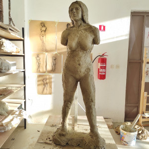 First life-size female clay nude.